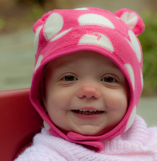 My granddaughter welcomes the new year with a smile.  Here's hoping we all have a year as happy as the glow on this face!